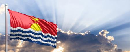 Kiribati waving flag on blue sky. 3d illustration Stock Photo