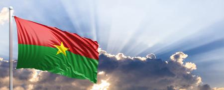 Burkina Faso waving flag on blue sky. 3d illustration Stock Photo