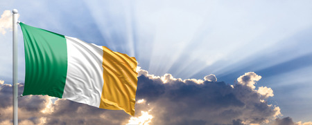 irish culture: Ireland waving flag on blue sky. 3d illustration Stock Photo