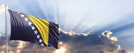 De golvende vlag van Bosnië-Herzegovina op blauwe hemel. 3D illustratie