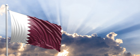 Qatar waving flag on blue sky. 3d illustration Stock Photo