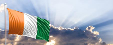 Ivory Coast waving flag on blue sky. 3d illustration Stock Photo