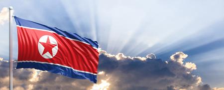 North Korea waving flag on blue sky. 3d illustration Stock Photo