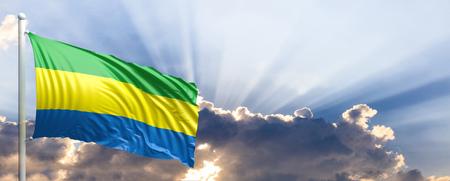 Gabon waving flag on blue sky. 3d illustration