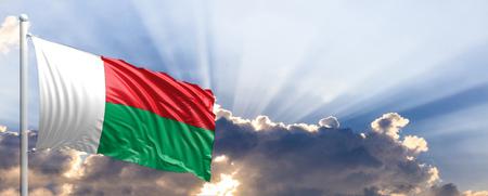 Madagascar waving flag on blue sky. 3d illustration