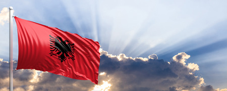 Albania waving flag on blue sky. 3d illustration
