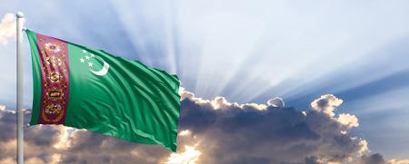 Turkmenistan waving flag on blue sky. 3d illustration Stock Photo