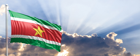 Suriname waving flag on blue sky. 3d illustration Stock Photo