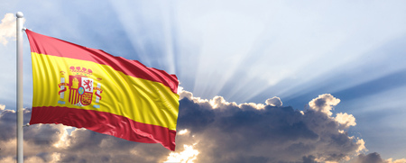 Spain waving flag on blue sky. 3d illustration Stock Photo