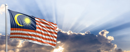 Malaysia waving flag on blue sky. 3d illustration