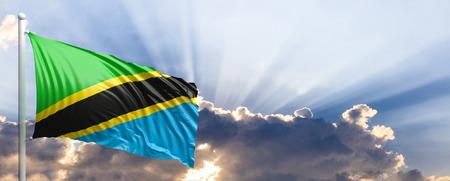 Tanzania waving flag on blue sky. 3d illustration