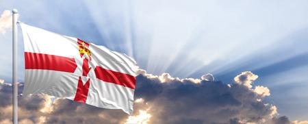 irish culture: Northern Ireland waving flag on blue sky. 3d illustration Stock Photo