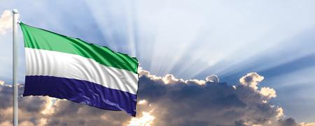 Sierra Leone waving flag on blue sky. 3d illustration Stock Photo