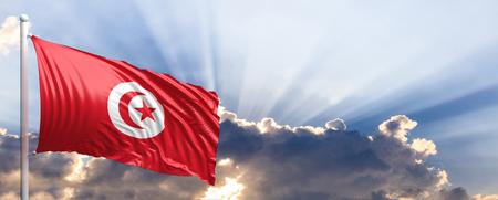 Tunisia waving flag on blue sky. 3d illustration Stock Photo