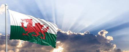 Wales waving flag on blue sky. 3d illustration
