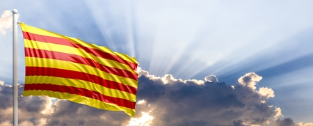 day: Catalonia waving flag on a blue sky. 3d illustration Stock Photo