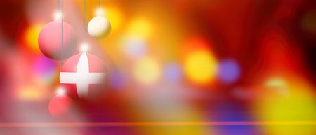 Denmark flag on Xmas ball. Christmas background corner design element featuring white bubbles. Blurred and abstract. Stock Photo