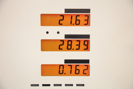 Fuel prices sign at the fuel station. Stock Photo
