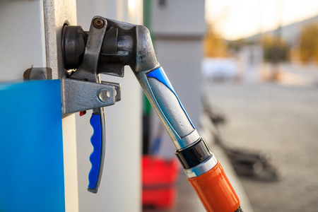 Fuel pistol close up at the gas station, abstract car background Stock Photo