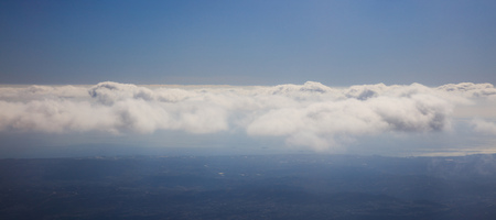 Blue sky backdrop with hanging clouds. Aerial photo from above, space for text, panoramic, banner.