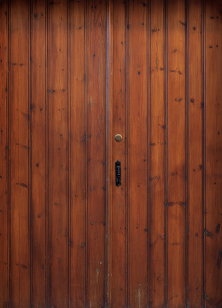 Wooden brown door, backdrop with latch and padlock, close up, details Stock Photo