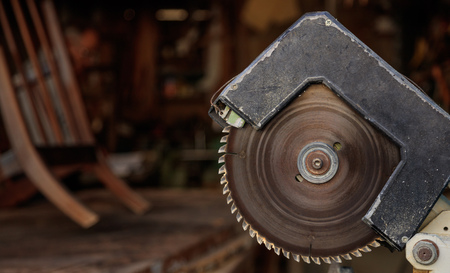 Electric saw from steel with circular jagged disc for woodwork. Blur backdrop, close up view, banner Stock Photo