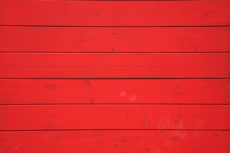 Wooden red background with horizontal planks. Vintage empty surface, close up view. Stock Photo
