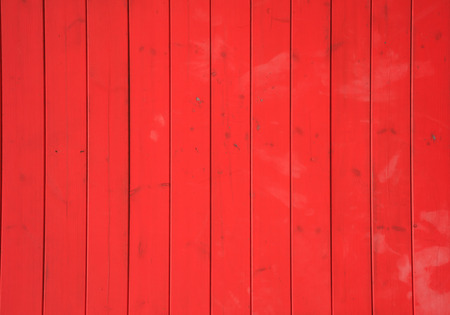 Wooden red background with vertical planks. Vintage empty surface, close up view. Stock Photo