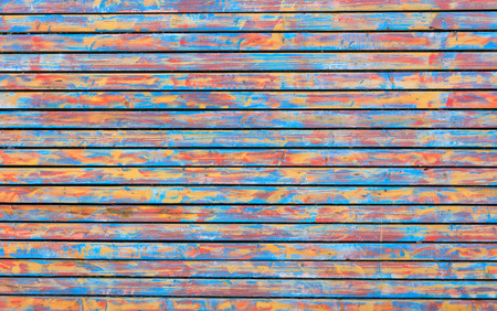 Wooden colorful background with horizontal planks. Vintage empty surface, close up view.