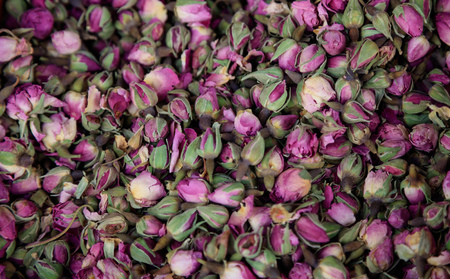 Roses pink, dried on heap. Antioxidant and healthy rosebuds for background. Close up view with details. Top view