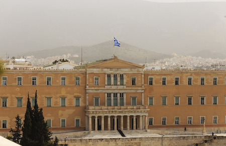 Greece, Athens pollution. UGrey smog over parliament at Syntagma. Sky, hill and town background. Stock Photo