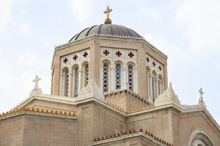 Mitropoli, historic Greek Orthodox Cathedral in Athens. Cloudy sky over Panagia Annunciation church.