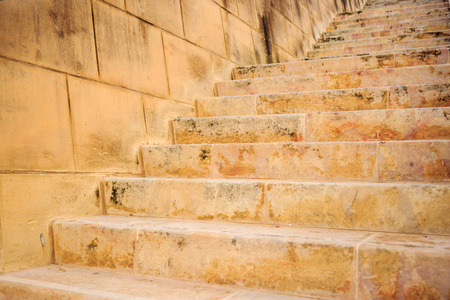 Stone wall and stairs in Valletta, Malta. Empty staircase for background. Close up view. Stock Photo