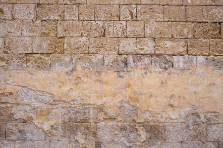 Limestone, sandstone brown, grey background. Weathered, peeled, vintage, empty wall for backdrop. Close up view with details. Stock Photo