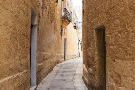 Mdina the traditional old town with cobblestone narrow streets, lanterns, peeled buildings, in Malta. Perfect destination for vacation and tourism. Stock Photo
