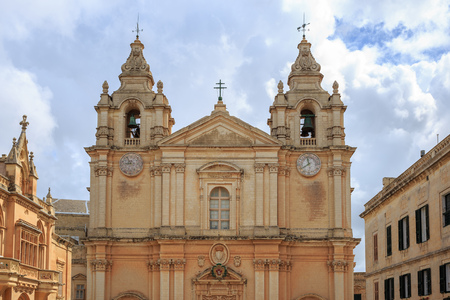 St Paul and Peter cathedral in Mdina, Malta. Catholic church under cloudy sky background. Ideal destination for pray and tourism. Stock Photo