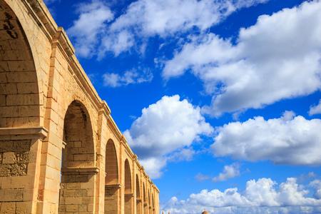 Upper Barrakka Gardens, Valletta, Malta. Stone terrace under blue sky with few white clouds. Upper view.