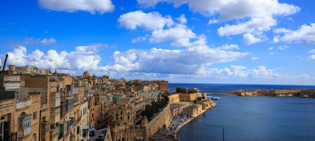 Malta, Valletta. Grand harbour in mediterranean. Blue sea and blue sky with few clouds background. Ideal destination for relaxing, cruise and tourism. Panoramic view, banner.