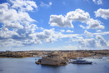 Malta, Valletta. Grand harbor in mediterranean. Blue sea and blue sky with few clouds background. Ideal destination for holiday, cruise and tourism. Panoramic view.