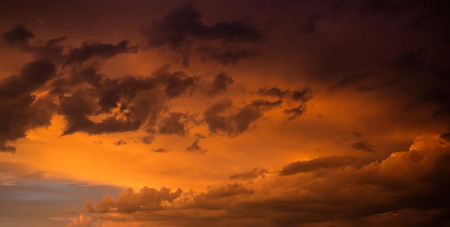 Dusk or dawn concept. Red cloudy sky at sunset, copy space, wallpaper. Stock Photo