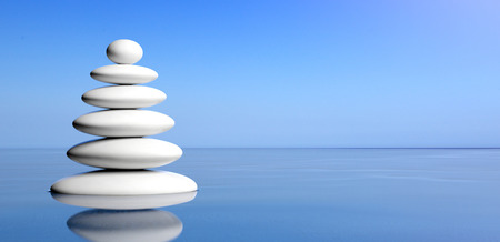 Spa concept. Zen stones stack on water, blue sky background. 3d illustration Stock Photo