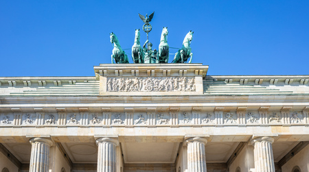 Brandenburg Gate In Berlin. Famous destination in Germany. Clear blue sky background. Stock Photo
