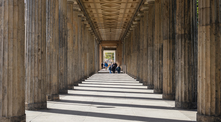 Altes museum, on Museum Island, Berlin, Germany. Sun pierces between the columns, make the path look like has stairs.