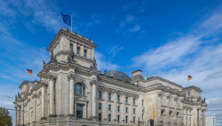 Reichstag building in Berlin, Germany. Under view of stately house, clouds travel on the sky background. Stock Photo