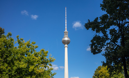 Television tower, Fernsehturm, under Berlins blue sky background. Famous destination for vacation.