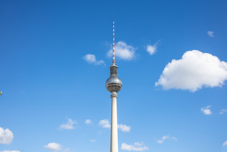 Communication concept. Television tower, Fernsehturm, under Berlins blue sky Stock Photo