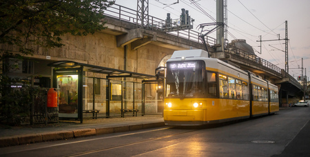Public transportation concept. Yellow electric tram ready for departure at Berlin, Germany.