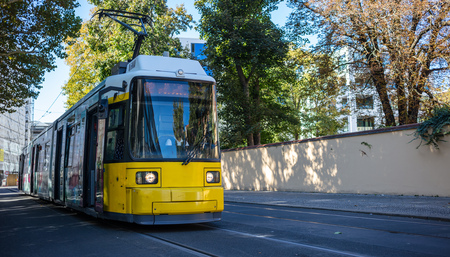 Public transportation concept. Tram yellow, modern, electric travels at Berlins town, Germany.