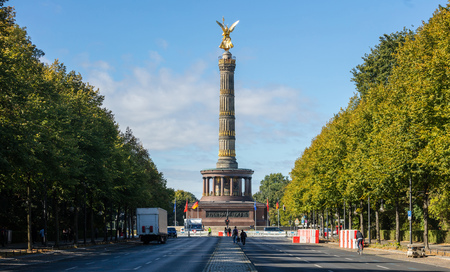 Berlin Victory Column. Golden statue of angel tries to touch the blue sky. Stock Photo