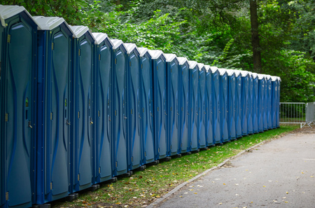Bio public toilets at a park. Locked, portable chemical lavatories that provide privacy and hygiene. Stock Photo
